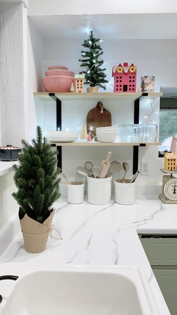Deck your kitchen out for Christmas with these simple touches that won't break the bank! #christmas #christmasdecor #christmasdecorations #christmaskitchen #kitchenshelves #christmasshelves