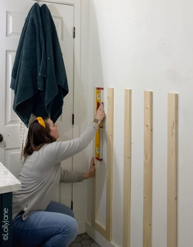 Transform a flat wall in a day with board and batten to make the room pop with this easy DIY Board and Batten Accent Wall! #boardandbatten #boardbatten #diy #accentwall #woodoworking