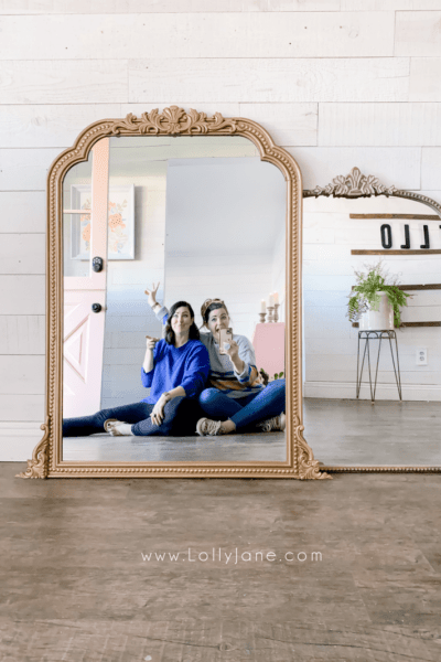 Turn any mirror into a gold ornate Anthro knock off with a few appliques and a gold can of spray paint. Love this easy Anthro mirror dupe! #anthrodupe #cheapAnthromirror #goldmirrordiy #howtospraypaintgoldmirror #anthroknockoffmirror #anthrocopycatmirror