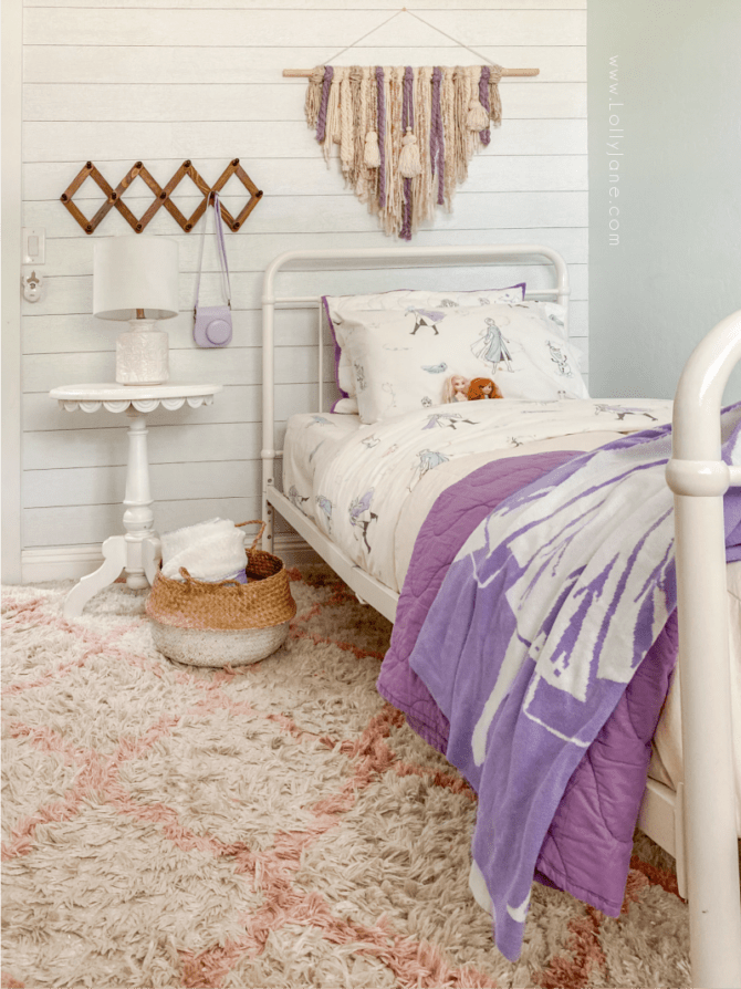 This Frozen 2 themed bedroom is so cute! It's got a boho style so it's not too juvenile for the youngest Frozen fans! Grab these tips to make your daughter's Frozen 2 dream bedroom come true!