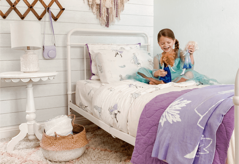 Check out these DIY Bedroom Ideas for Frozen 2 Fans! Your little princes will adore this mature Frozen 2 bedding, complete with cozy shams and soft sheets. Love this Frozen 2 themed bedroom!