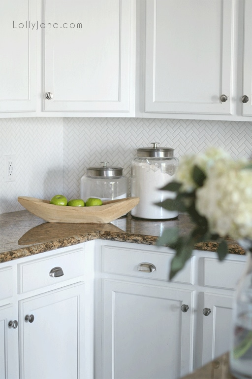 Are you considering small or large herringbone for your kitchen backsplash? We chose the smaller tile to create visual interest. We don't keep a lot of storage on our counters so the herringbone backsplash is the star of the show with the classic look.