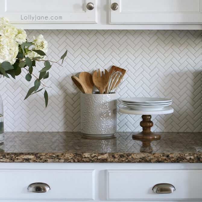 We love our white herringbone backsplash with bright white kitchen cabinets. It's easy to wipe down and creates a timeless, classic look.
