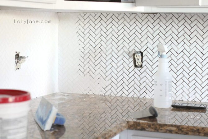 Consider white grout when installing white herringbone for a kitchen backsplash. Such a classic white kitchen that will last for years to come.