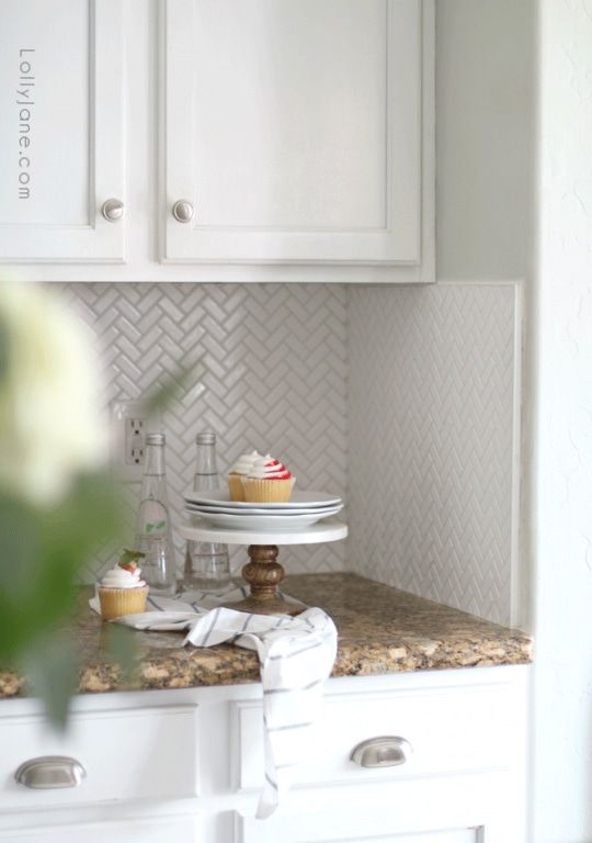 If you're looking for a way to update your kitchen without a full remodel, consider tiling a herringbone backsplash. We love our mini herringbone tiles for visual interest and easy cleaning.