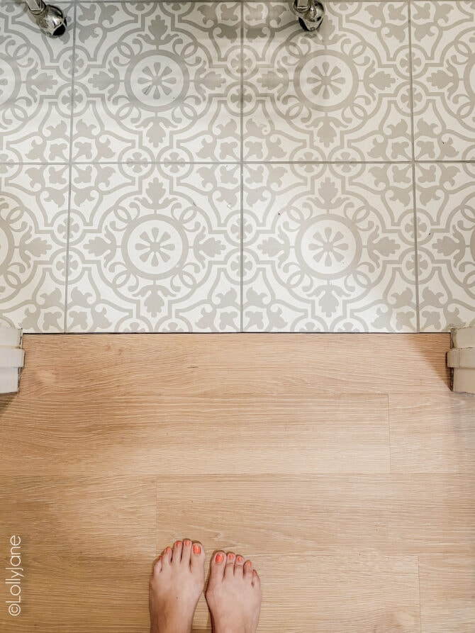Love the combo of this mosaic laundry room meets warm oak LVP floor... can't believe that's not real hardwood! WOW!