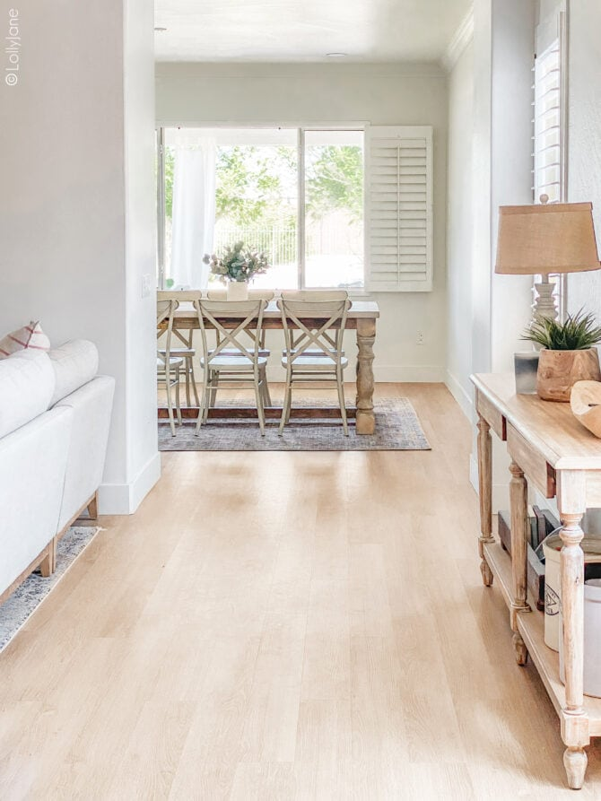 Stunning Luxury Vinyl Plank Flooring, so warm and inviting (looks JUST like real hardwood floor but without the maintenance!) in this cozy craftsman style home! Love the warm oak finish!