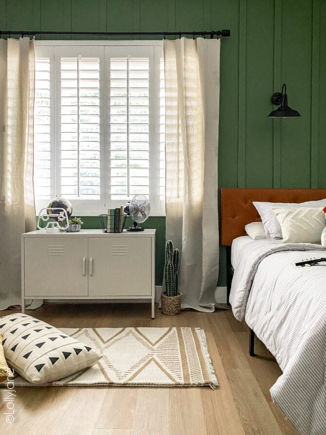 Walmart FTW! Cutest decor in this shared modern farmhouse style bedroom... and that wall treatment in the dreamiest shade of green is the perfect touch!