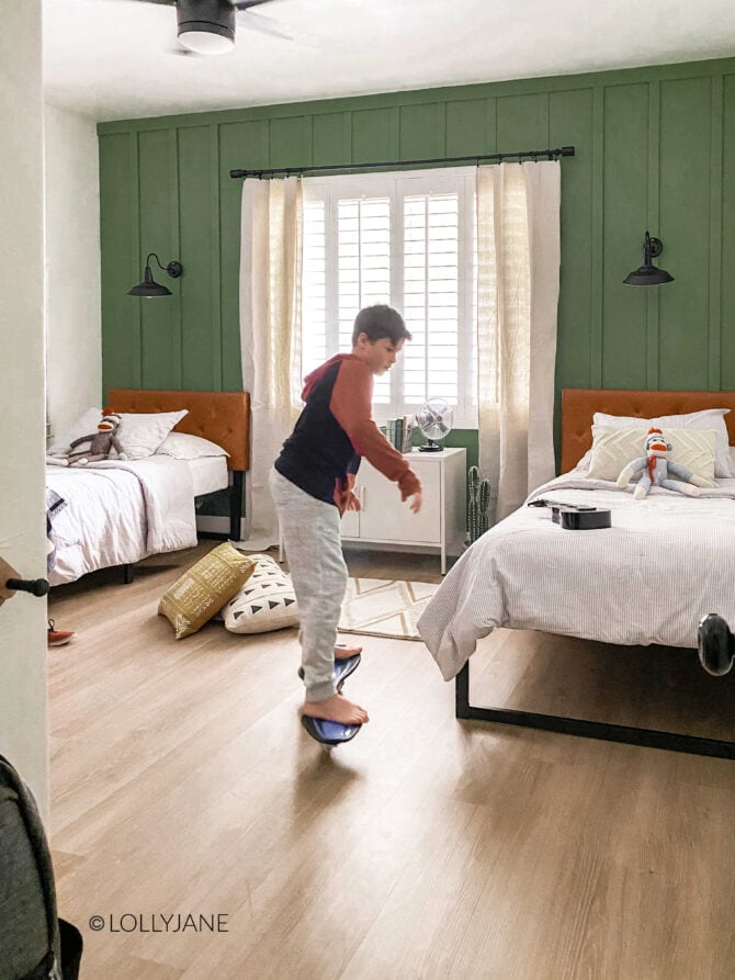 Love this shared modern farmhouse style bedroom, cutest wall treatment and love that green paint color!